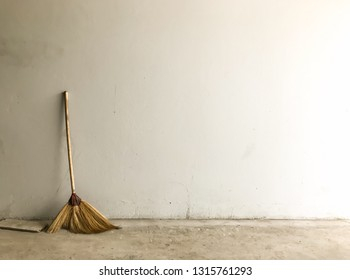 Landscape a broom against wall