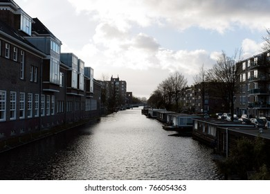 Landscape of a building next to the canals in Amsterdam city