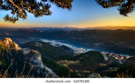 Landscape - Bulgarian mountain town viewed from hilltop during sunset