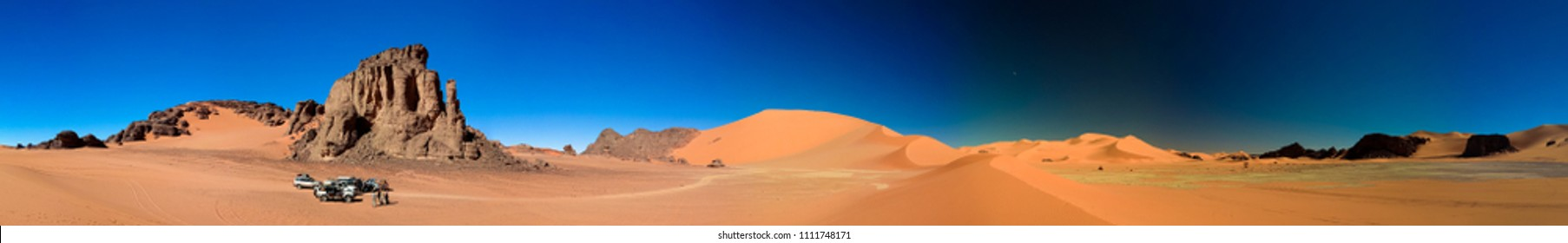Landscape of cand dune and sundstone nature sculpture with car at Tamezguida in Tassili nAjjer national park in Algeria