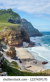 Landscape of the Cape Point - sandy Dias beach and two lighthouses on the rocks on the horizon. Cape of Good Hope, South Africa