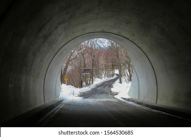 Landscape with Car tunnel and road go to the snow mountain at the Kamikochi in Japan Alps Mountain. Winter season concept. Dark tone.
