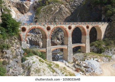 Landscape of Carrara's marble quarry in Tuscany (Italy) with the distinctive bridge in the locality Ponti di Vara