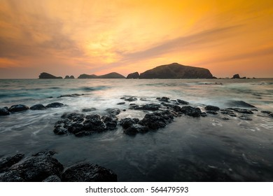 Landscape with Chagwido Island and strange volcanic rocks, view from Olle 12 corse in Jeju Island, Korea.