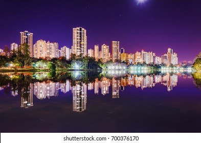 Landscape of the city, buildings, the lake Lago Igapo and the city lights. Beautiful city lights reflected on the water of the lake at night. Photo at Londrina - Parana, Brazil at night.