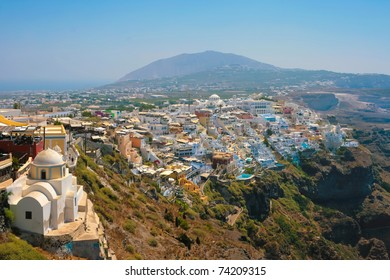 Landscape of city Fira with traditional houses on island of Santorini, Greece.