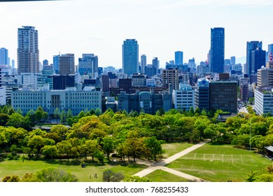 landscape and cityscape view of osaka city with big public garden,japan.