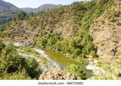 landscape with the clear waters of Orba river flowing in deep gorge in Ligure inland near Tiglieto, Italy