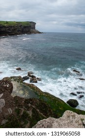 Landscape with cliff. A cloudy summer day on the coast of Cantabria. Spain