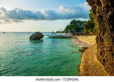 Landscape: cliffs and the sea with boats. Boracay island. Philippines.