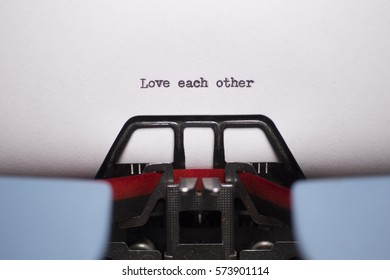 Landscape Close Up of Love Each Other Typed on Vintage Typewriter