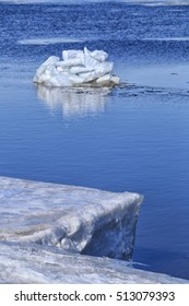 landscape close-up large ice floes on the river against the blue sky on a sunny day in early spring