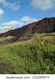 landscape in the coal pile stock area, there appears to be a unit stacker reclaimer