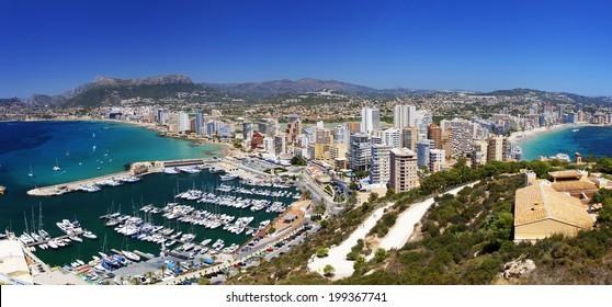 Landscape of coastline with beaches, yachts, city under the bright sun (Coast Spain, Calpe)
