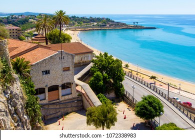 Landscape  coastline of Costa Dorada surroundings of Salou - sea, beach, palms and tiled roofs of houses, view of with Mediterranean Balcony, Tarragona, Catalunya, Spain