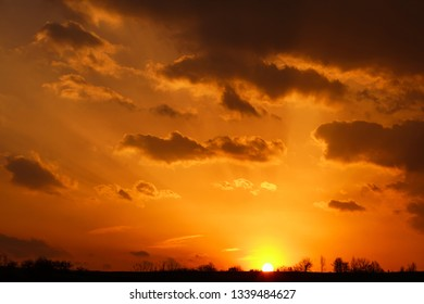 Landscape of colorful dramatic sky in the clouds in the rays of sunset light, beautiful nature background