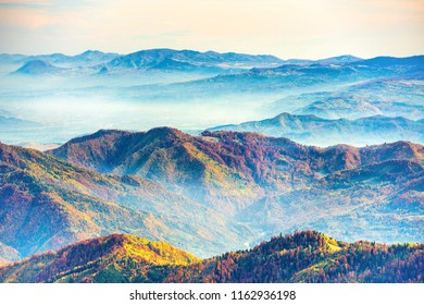 Landscape with colorful mountain ranges at sunset