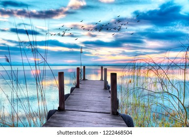 landscape of a colorful sunset over the water of the lake