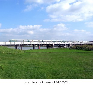 Landscape of commuter train crossing a river