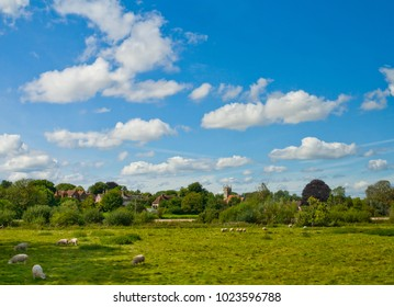 Landscape with Cotswold village seen from the passing vehicle in in south central England