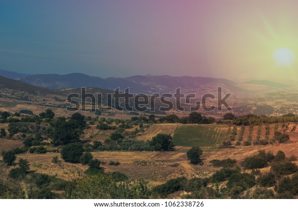Landscape of the countryside in Greece. Fields and agricultural machinery in Greece