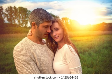 landscape couple standing in higher grass