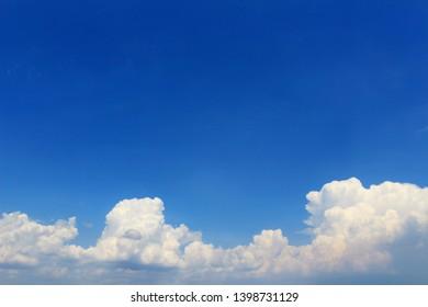 Landscape of cumulonimbus clouds floating in sunny summer sky