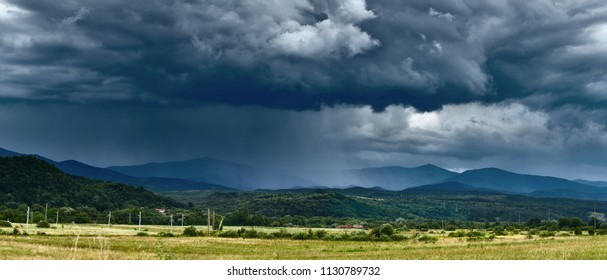 Landscape with curtains of torrential heavy rain in the mountains