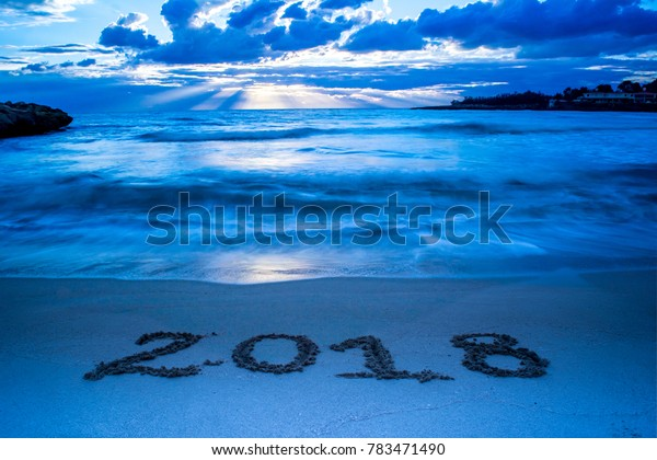 Landscape With Cyan Foggy Sea At Sunrise And The Sign 2018 Written On The Sand On Cloudy Sky Background