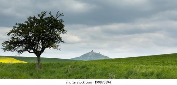 Landscape in the Czech Central Mountains, castle Hazmburk