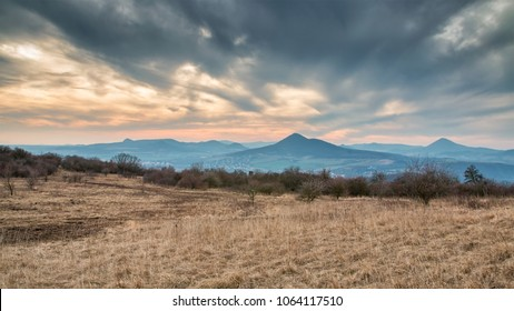Landscape of Czech central mountains with Milesovka hill during sunset