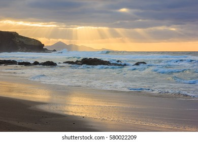 landscape, dark sky over the ocean, the sun's rays