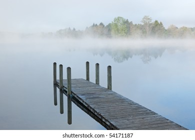 Landscape of dock in fog, Whitford Lake, Fort Custer State Park, Michigan, USA
