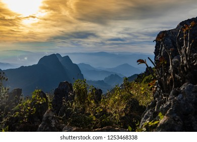 Landscape of Doi Sam Pee Nong from peak of Doi Luang Chiang Dao, Chiangmai, Thailand. Beautiful sunset mountain covered by fog with sky full of clouds.