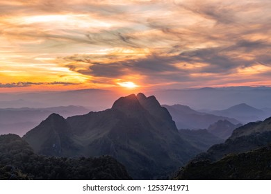 Landscape of Doi Sam Pee Nong from peak of  Luang Chiang Dao, Chiangmai, Thailand. Sunset time with beautiful twilight sky. Faraway mountain covered by fog.