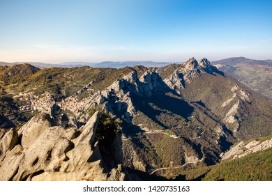 Landscape of Dolomites of Basilicata mountains called Dolomiti Lucane.  In the background Castelmezzano village. Basilicata region, Italy