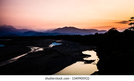 Landscape during the sunset in Villa Tunari, Bolivia. High contrast pic with the river and the mountains in the back