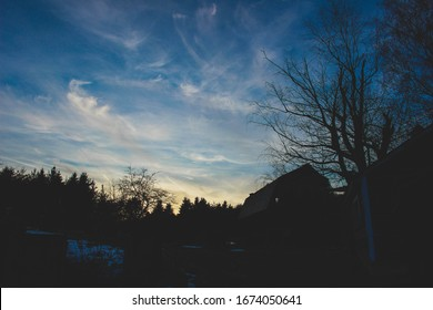 landscape at dusk with a barn roofline