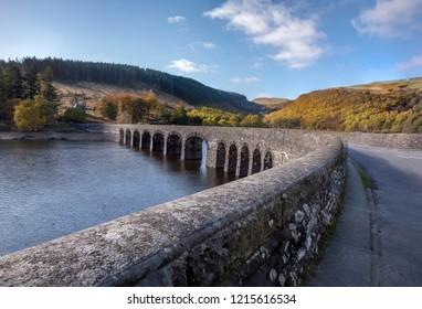 Landscape of Elan Valley Reservoir Wales UK including a multi-arched bridge