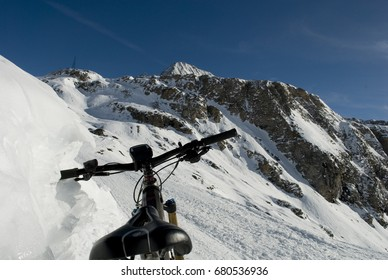 landscape: electric bicycle, e-bike, mountain bike on the snow of the mountains of Formazza Valley, Riale, Alps, Italy