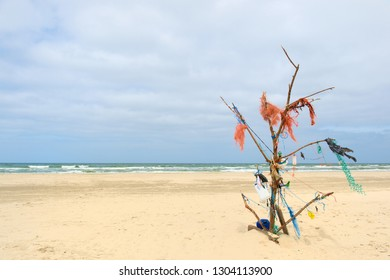 Landscape empty beach with tree made from rubbish at Dutch island Terschelling