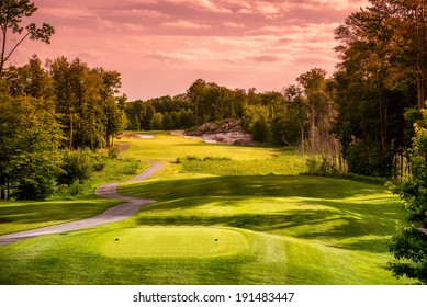 Landscape of an empty  golf course close to sunset or sunrise.
