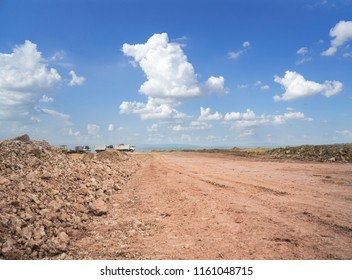 Landscape of empty land plot for industrial development, real estate or housing construction project Reclamation traitor and excavator dump truce car and beautiful blue sky.  Land for sales concept