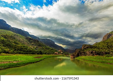 Landscape of the Euphrates River ( Turkish: Firat Nehri ) with cloudy sky in Kemaliye, Erzincan, Turkey. The Euphrates is the longest and one of the most historically important rivers of Western Asia.