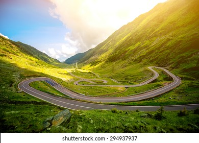 Landscape from the Fagaras mountains with Transfagarasan winding road in Romania