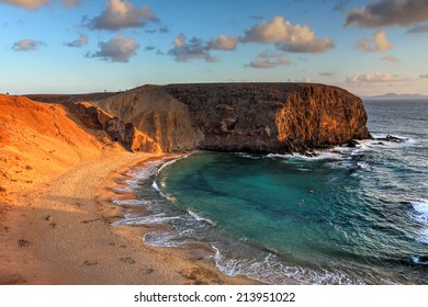 Landscape with the famous Papagayo Beach on the Lanzarote Island in the Canary Islands Archipelago, Spain at sunset time.
