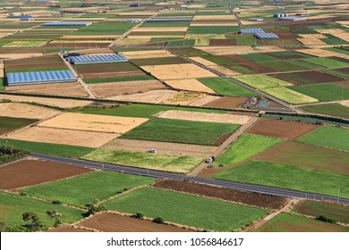 Landscape of Farm filed in Daejeong-eup and Hangyeong-myeon, viewed from the summit of Dang Oreum in Jeju island, Korea.