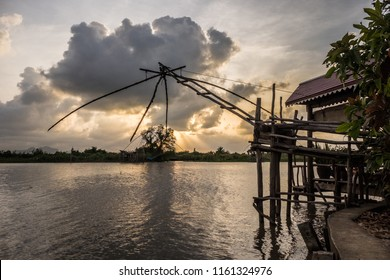 """Landscape of fisherman's village in Thailand with a number of fishing tools called """"Yok Yor"""", Thailand's traditional fishing tools that made form bamboo and fishing net."""