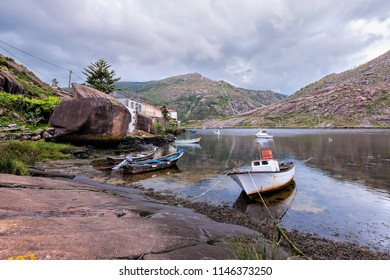 Landscape with fishing boats moored  on shore. Galicia Spain.