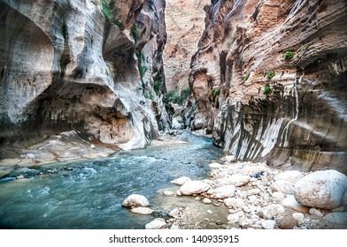 Landscape of flowing water of creek in Wadi Hasa, Jordan